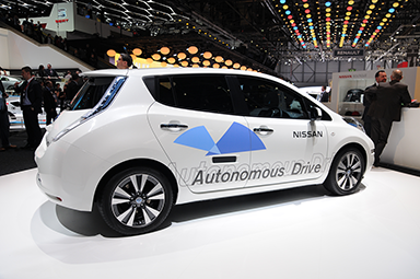 A white car with Autonomous Drive written on its side.