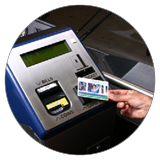 Image of a hand tapping a CharlieCard on a MBTA fare machine.
